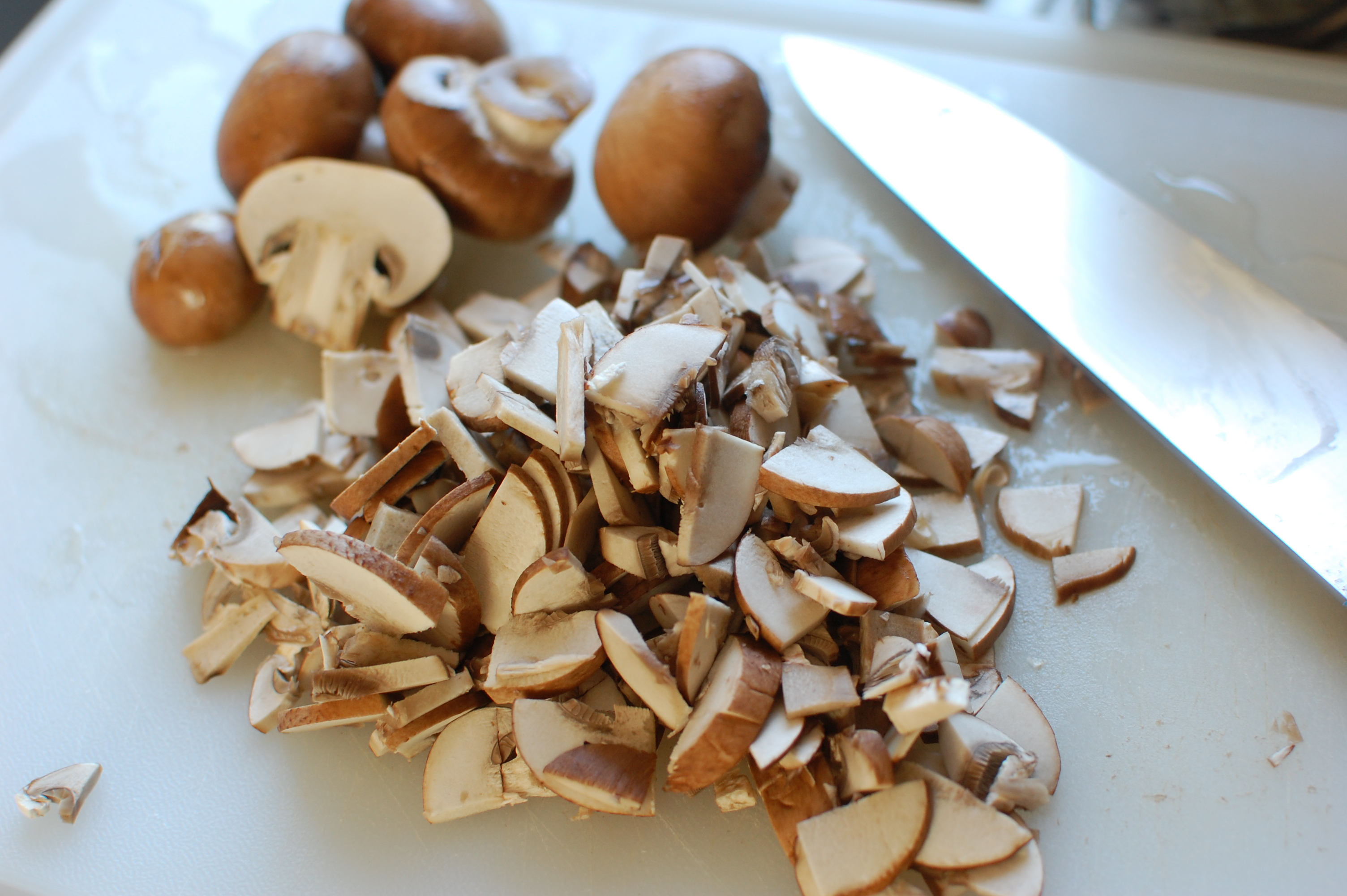 Heat the oil in a wok or frying pan, and saute the mushrooms until ...