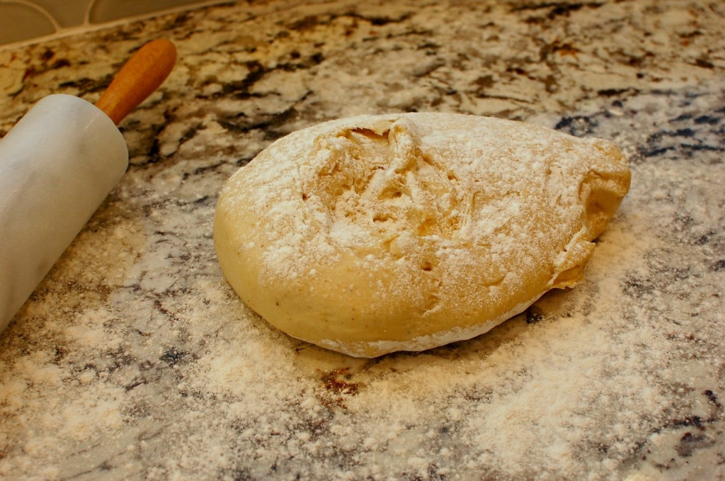 Dust the dough with flour, then roll into a large rectangle (using ...