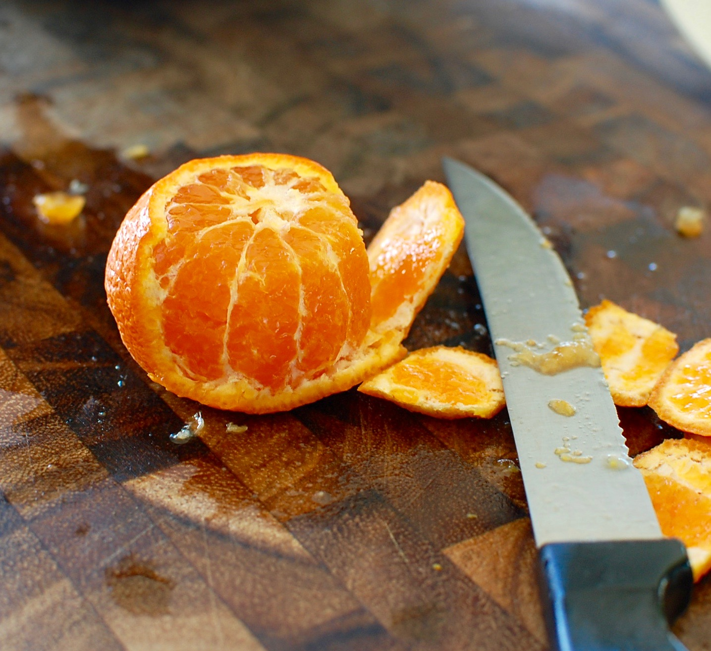 To Segment A Tangerine Cut The Top And Bottom Off Then Set On Cutting Board Peel Vertically Around Fruit Over Bowl